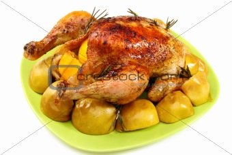Chicken stuffed with lemons, apples and rosemary.