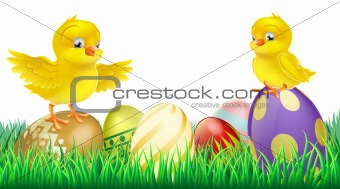 Cute yellow chicks on Easter eggs