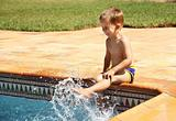 Happy boy having a fun at swimming pool