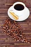 White cup and coffee beans