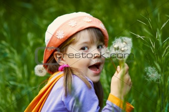 funny girl with dandelions