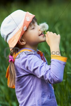 cheerful girl with dandelion
