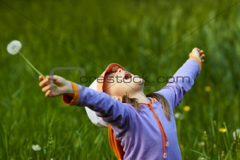 happy girl with dandelion