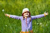 joyful girl with dandelion