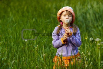 girl with a dandelion in the hands of