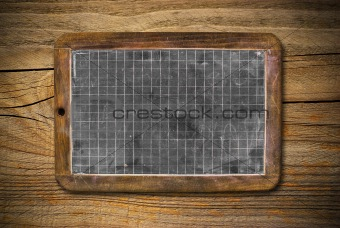 old blackboard and wooden background