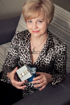 beautiful blonde woman holding present