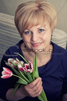 beautiful woman holding tulips