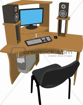 Table with a computer and speakers