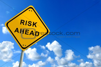 risk ahead traffic sign on bluesky
