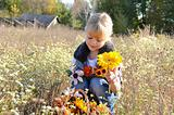 Autumn child with flowers