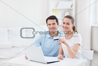A couple with a credit card