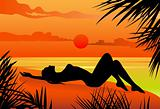 Girl lying on the beach silohuette