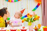 Mother giving birthday present for baby
