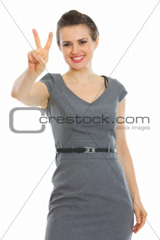 Business woman showing victory gesture