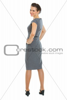 Smiling business woman turn round