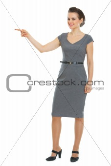 Business woman pointing in corner