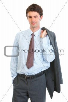 Portrait of happy business man with jacket on shoulder