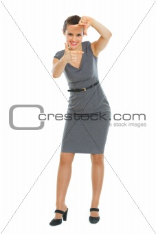 Business woman making frame with hands