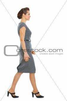 Business woman walking in corner
