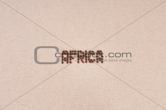 Canvas with coffee beans forming the word Africa