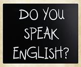 """Do you speak english"" handwritten with white chalk on a blackbo"