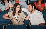 Woman Hits Man in Theater