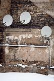 Satellite dishes on a wall