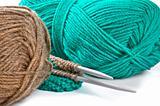 Woollen thread and knitting needle. Needlework accessories on white background.