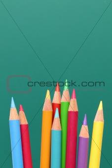 Group of pencils, blackboard behind