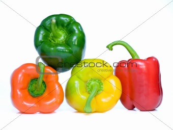 Four pepper on white background