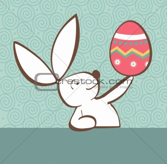 Easter bunny with painted egg
