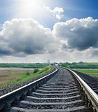 railway to horizon under cloudy sky