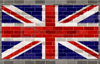 Flag of great britain on large rough gray brickswall