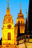 prague - different architectural styles-st. nicolas church and charles bridge tower