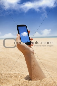 smart phone in hand and beach view with cloud computing concept