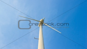 white wind turbine on blue sky
