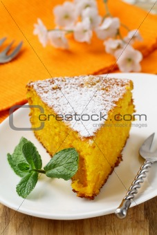 Carrot cake with powdered sugar and mint
