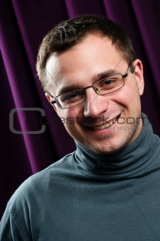 Smiling man with glasses portrait