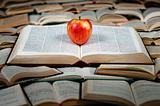 Red apple on big book