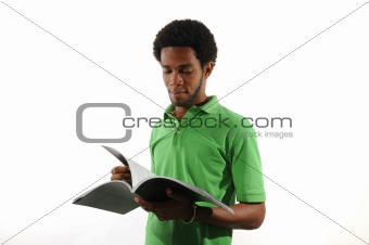 Young african man reading a magazine