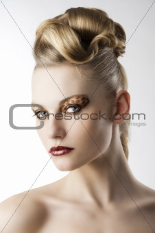 fashion girl with leopard makeup, she is turned of three quarter