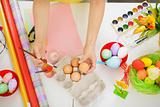 Preparations for Easter. Closeup on hands painting on egg.