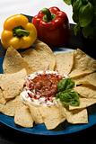 Plate of nachos with sour cream and salsa