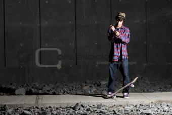 Skateboarder fixing his cuff