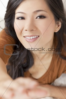 Beautiful Young Asian Chinese Woman Reaching To Camera