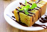 piece of orange cake with chocolate sauce