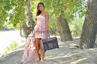 beauty girl in a old-fashioned dress in a forest