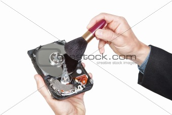 Cleaning open hard disk with brush. On a white background.