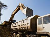 Excavator loader and truck